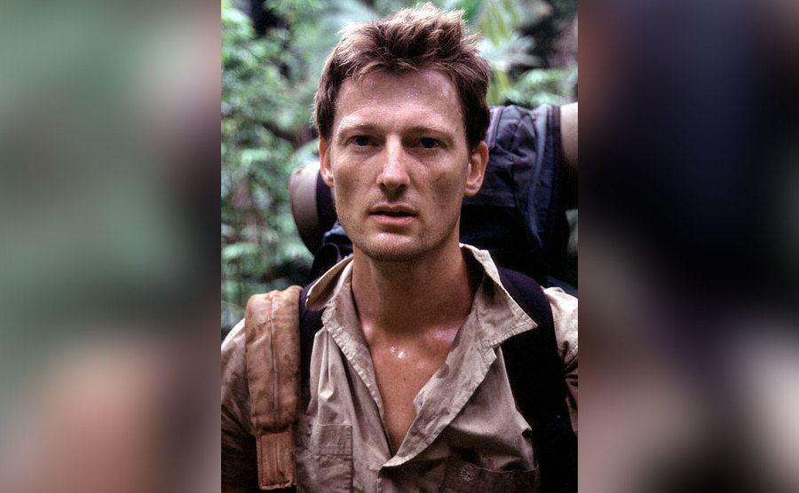 Benedict Allen is hiking through the jungle.