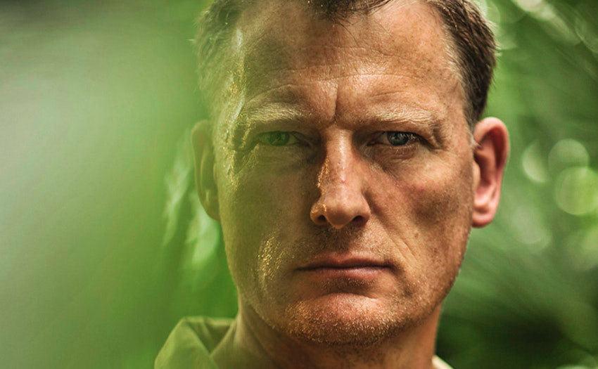 A closeup of Benedict Allen in the jungle.
