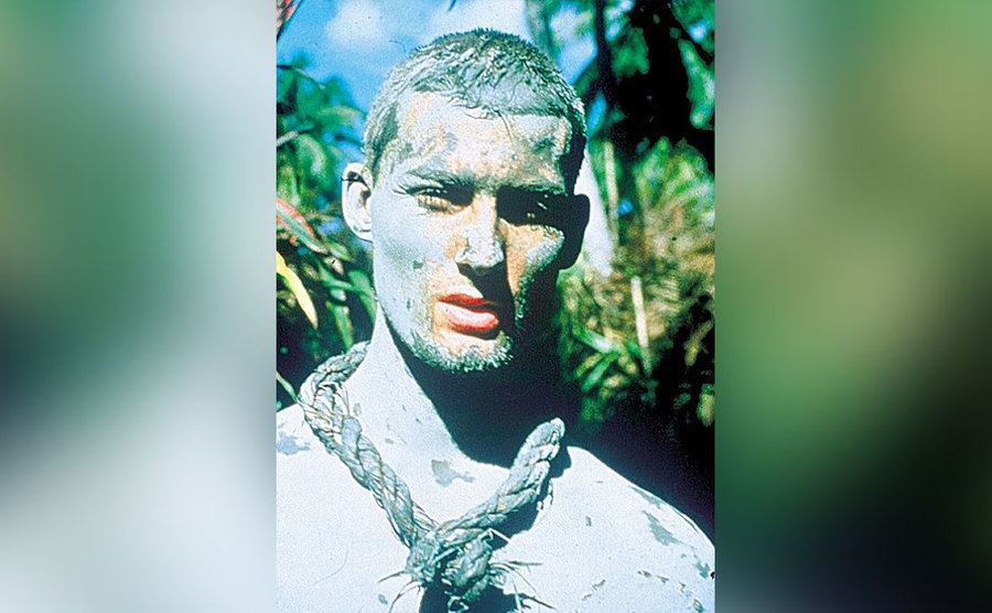 Benedict Allen is covered in dry mud.