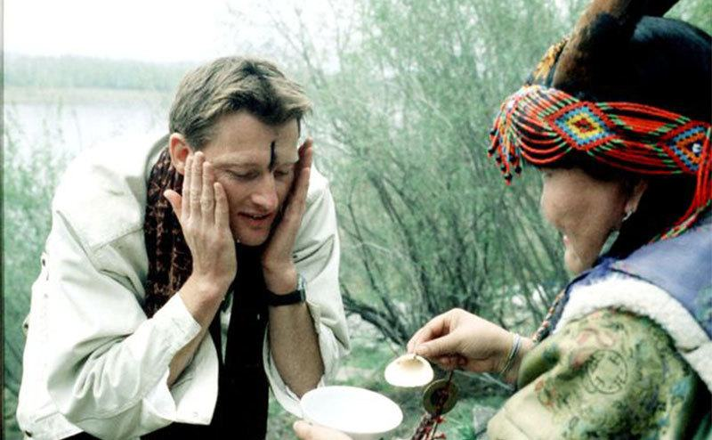 Allen washes his face as part of a traditional ceremony on one of his trips.