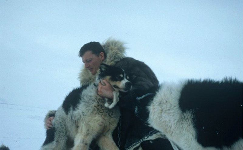 Allen embraces a dog while on his trip to Sibiria.