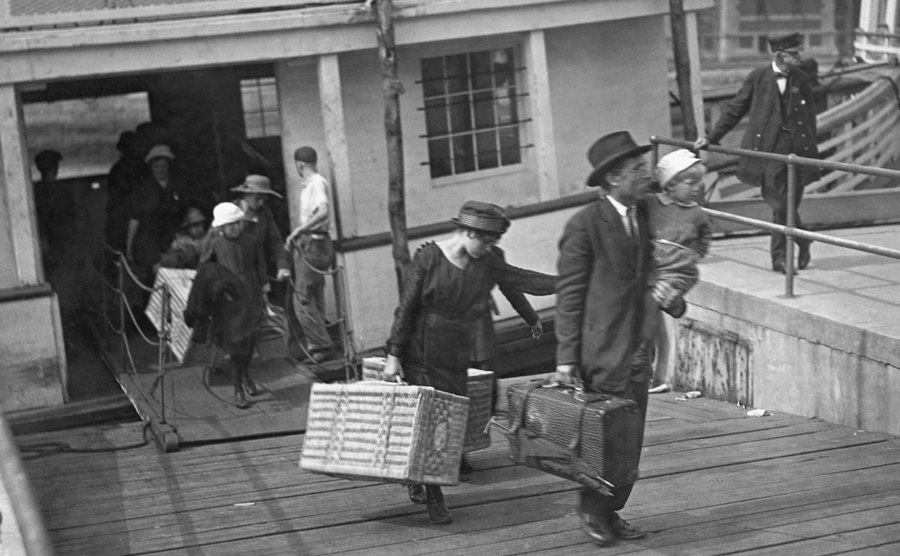 Immigrants are leaving Ellis Island after inspection.