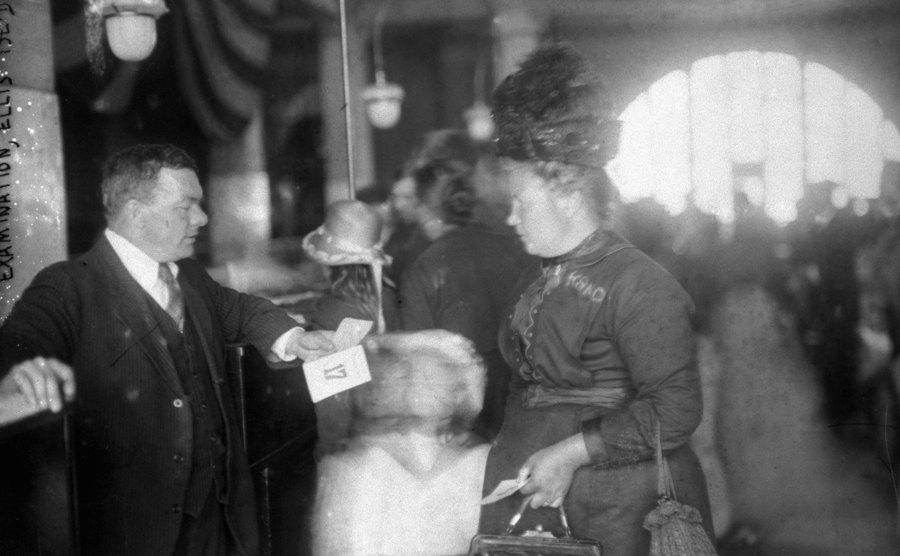 An officer examines a female immigrant.