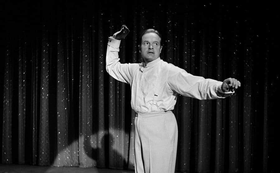 Bob Hope performs on stage.