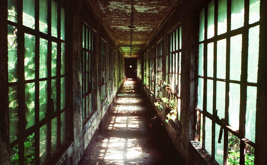 A decayed corridor between buildings on Ellis Island.