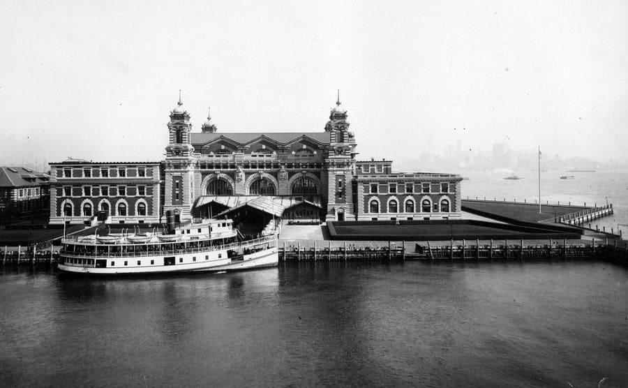 An exterior photograph of the front facade of Ellis Island.