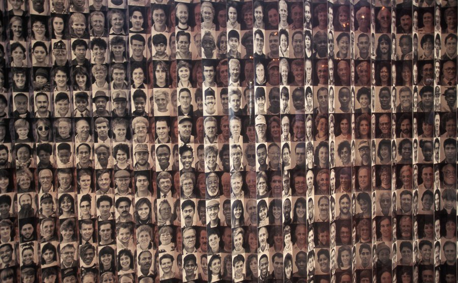 Pictures of Americans are displayed on the wall at the Ellis Island Museum.
