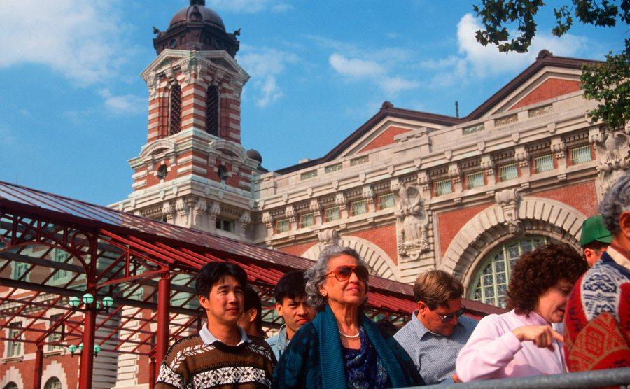 Tourists are entering Ellis Island National Park.