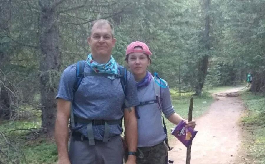 John and his daughter go for a hike.