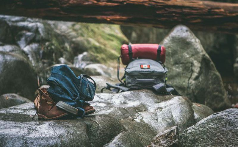 A photo of hikers' bags on the rocks.