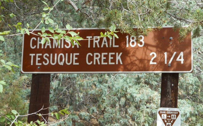 A sign that reads ''Tesuque Creek.''